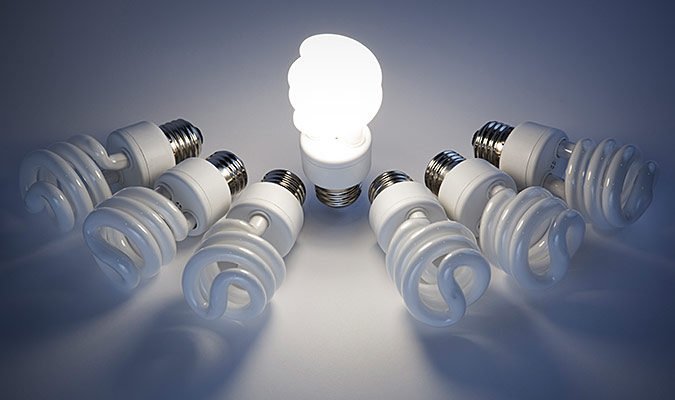 One lightbulb is lit among many that are dead.