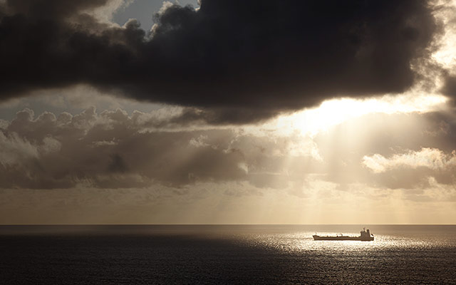 Image of a ship in the middle of teh ocean