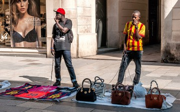 Street vendors selling purses and shirts