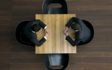 Overhead image of two men sitting at a table
