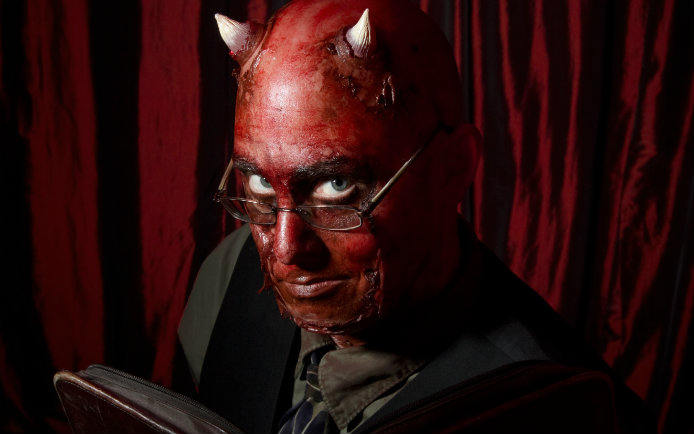 Image of the devil wearing glasses