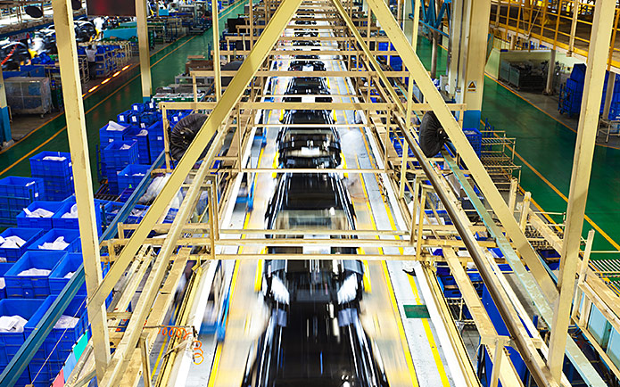 Cars being manufactured in a factory
