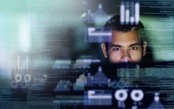 Image of a man looking at digital data