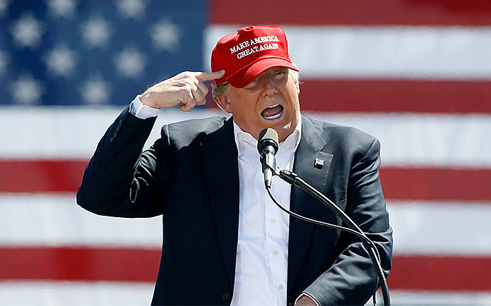 """Image of Donald Trump wearing a """"Make America Great Again"""" hat"""
