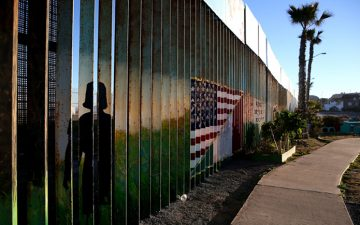 A photo of the US-Mexican border fence at Playas de Tijuana