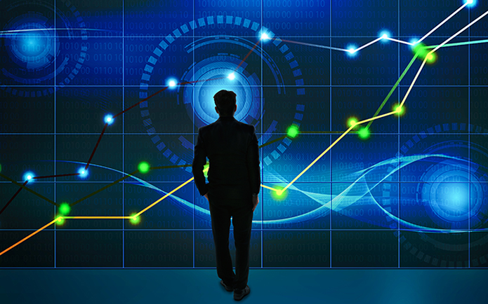 Businessman looking at big screen with business chart