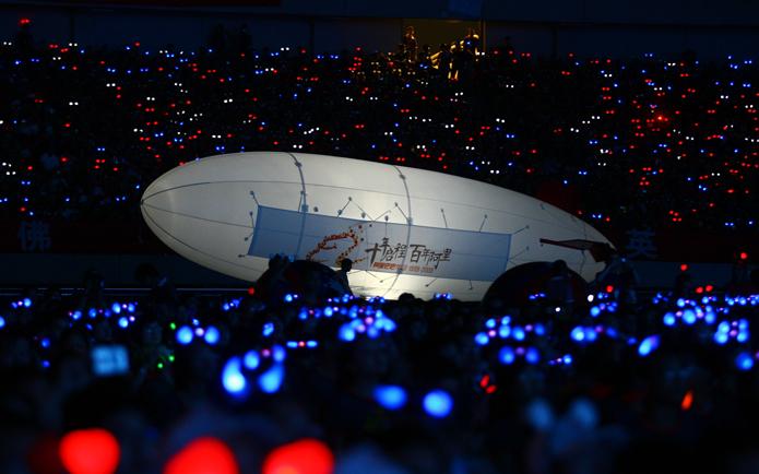 A giant elongated balloon in a dark stadium