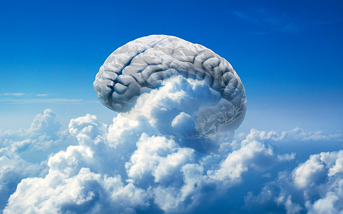A brain in the sky surrounded by clouds