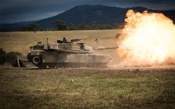A tank firing off an explosive shot
