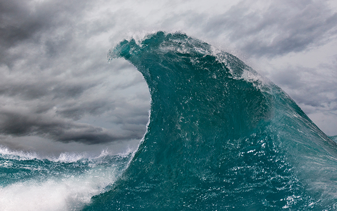 A stormy sky with a giant ocean wave