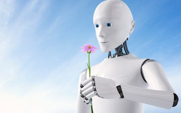A white robot smelling a purple flower