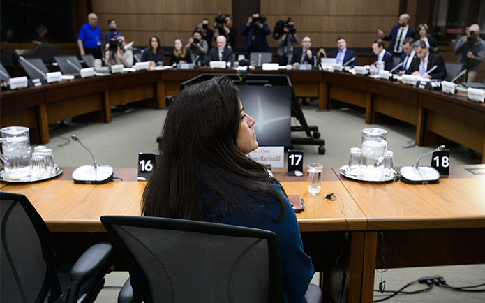 Jody Wilson-Raybould sitting at a set of tables in a circle