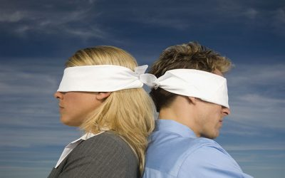 blindfolded-businesspeople-standing-back-to-back